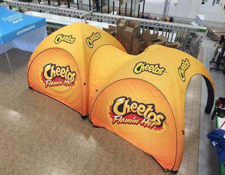 example of a custom inflatable event tent for Cheetos event marketing and sampling