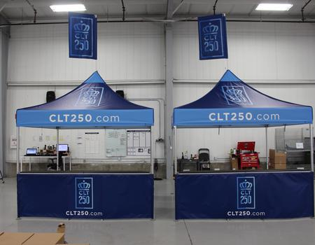 example of pop up event tents with custom printing and peak flag accessories