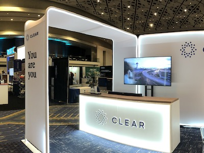 Three custom media walls at an indoor event with CLEAR branding.