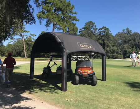 The Nitrox AIRFRAME inflatable tent set-up at Club Car product demo at golf course.