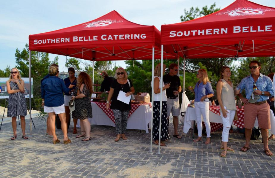 two printed red 10x10 pop-up tents made for food catering company with customers gathered around