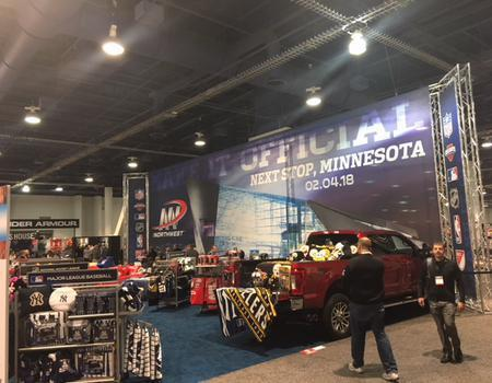 A large 100' truss event structure at indoor car show.