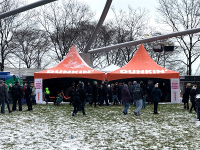 two Dunkin Donuts branded 20x20 frame tents outside in winter event