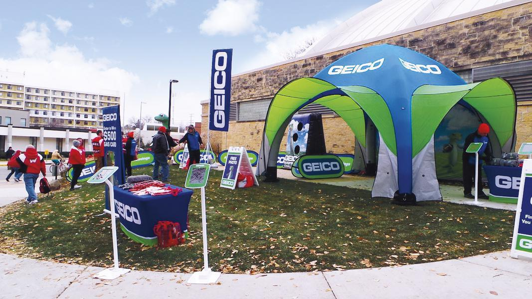custom printed inflatable GYBE tent with sun shades branded with Geico logos at college campus
