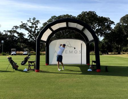 The Nitrox AIRFRAME inflatable tent with white wall used for product demonstration at golf course.