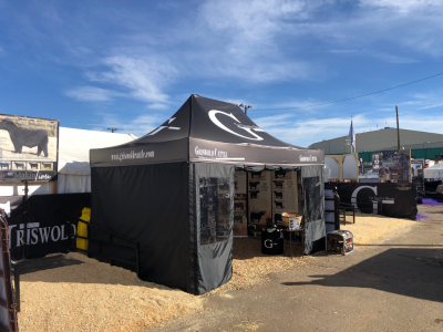 10x20 black printed canopy and custom windowed walls made for farming event