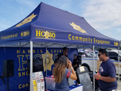 10x20 sheriff's branded pop-up tent with community engagement printed on valance