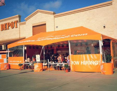 20x40 large frame tent with Home Depot branding and tent walls saying now hiring