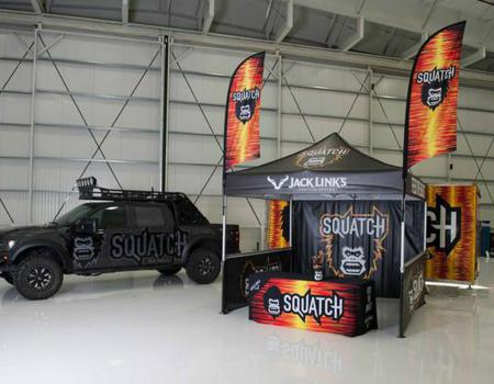 10x10 pop-up tent with custom flags and walls made for Jack Links Jerky with Sasquatch design