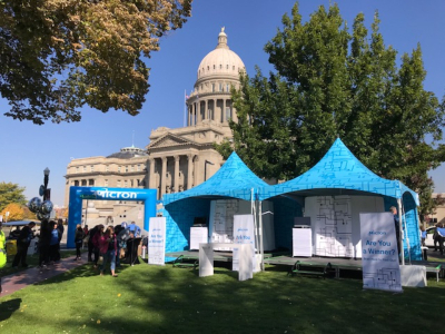 two custom printed blue frame tents and walls at state capitol building