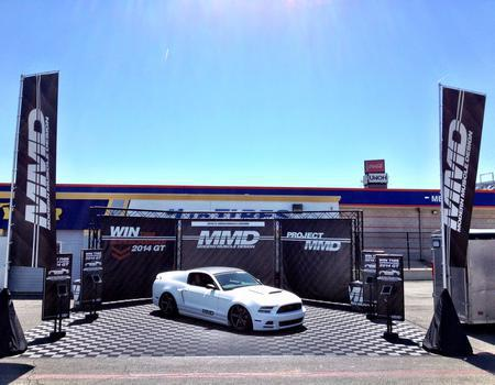 custom printed truss walls and large printed flags at outdoor car event