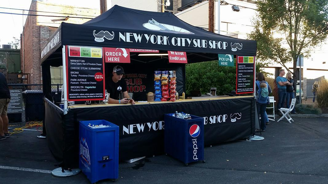 10x15 branded pop-up tent with countertops and walls used for food concessions at New York outdoor fair