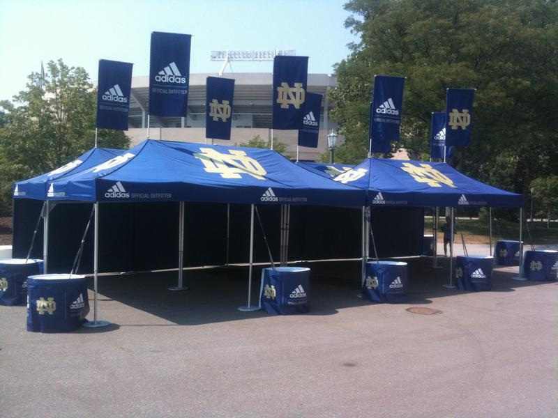 10x20 pop up tents with custom peak flags for Adidas & Notre Dame partnership