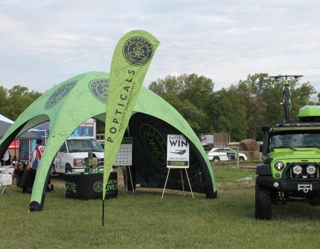 example of a 17x17 branded inflatable tent for Popticals event marketing