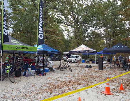 example of customized 10x10 pop up tent for Quikcover's mobile bike repair at races
