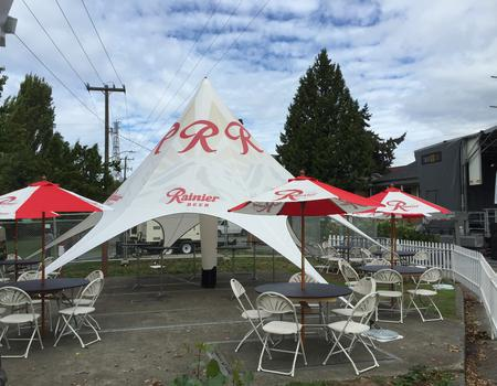 branded inflatable event tent with matching umbrellas made for Rainier Beer