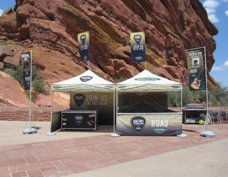 two 10x10 custom printed pop-up tents and flags set-up at Red Rocks Colorado