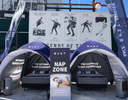 custom printed inflatable GYBE tent at mattress product demonstration