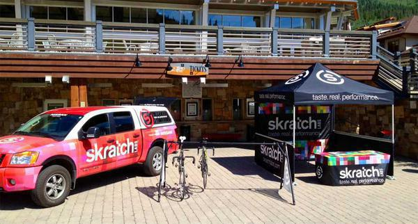 custom printed 10x10 pop-up tent with Skratch Labs branding at ski resort
