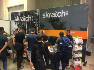 two stretch media walls with Skratch Labs branding and product sampling