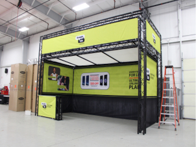black painted truss structure and custom printed walls for Straight Talk Wireless