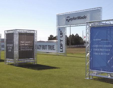 A Taylor Made experiential truss event structure set-up at golf course.