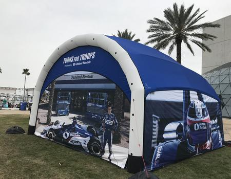 A blue and white Nitrox AIRFRAME inflatable tent with full UV printed race walls.