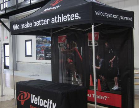 example of a 5x10 tent with back wall and printed table cover