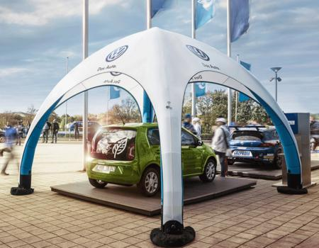 17x17 inflatable GYBE tent custom printed with Volkswagen logos with e-Golf car underneath