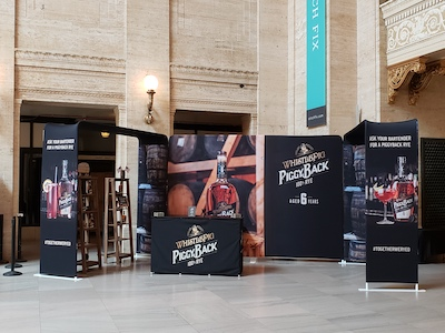 Printed media walls with alcohol branding used in Grand Central Station, NY.