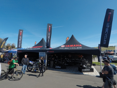 20x20 custom printed canopies with Yamaha Bicycles logo and rectangle flags for Sea Otter Classic bicycle festival