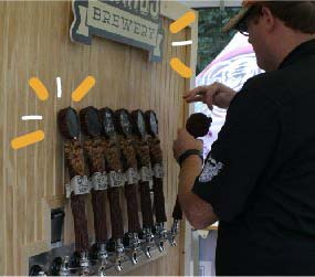 Beer taps installed on custom beer festival pop-up tent.