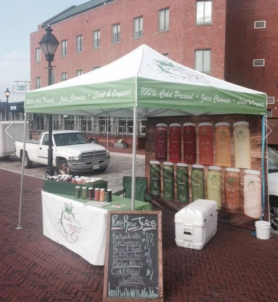 The medium-duty pop-up tent with custom back walls created for juice company at product demos.