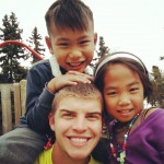 Zach Haynie, a student at South Plains College, plays with children at the Anchorage Mission Leadership Bootcamp in Alaska.