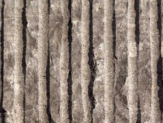 Cracked and crumbling concrete 0032