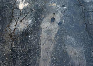 Damaged asphalt terrain 0001