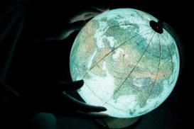 glowing globe hands