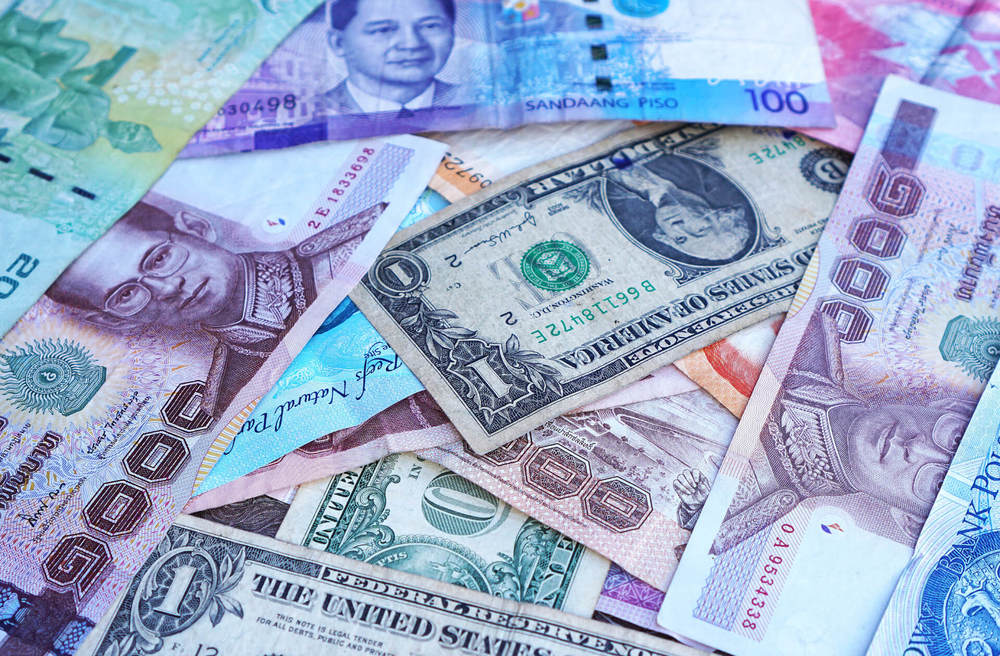 Managing Currency Risk: As an American Abroad, In What Currency Should I Save and Invest?