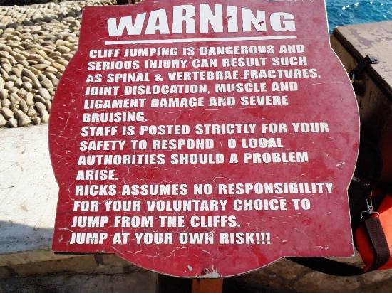Cliff diving warning sign at Rick's Cafe Negril | That Redhead