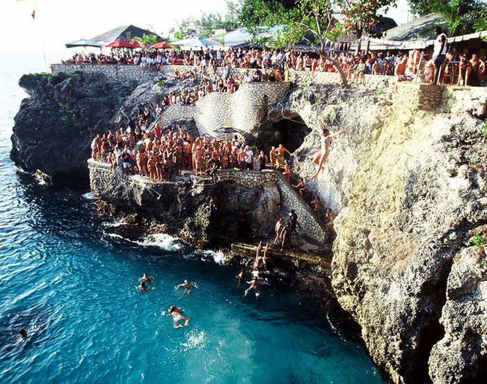 Rick's Cafe in Negril, Jamaica. Cliff diving, reggae, sunsets.