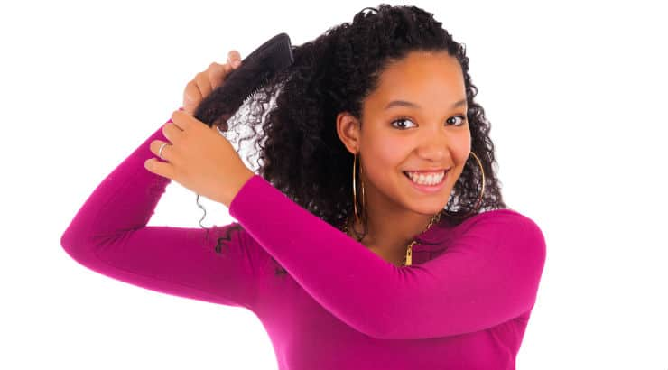 Black woman combing her hair