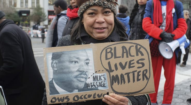 African American older woman holding a picture of Martin Luther King Junior