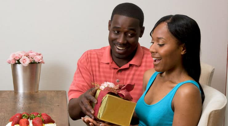 Husband Giving Wife A Present For Black History Month
