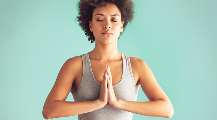 A picture of a black woman doing yoga