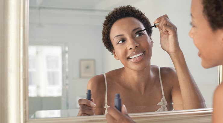 Black Up Cosmetics - African American Woman Applying Mascara