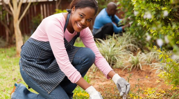 A Proverbs 31 Woman Is Industrious Black Woman Working with Her Husband in Their Garden