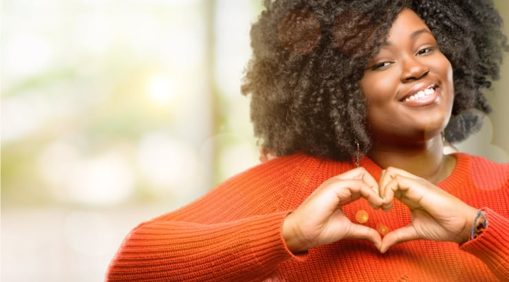 Black Woman Expresses Assurance For Her Mate By Indicating With A Heart Sign