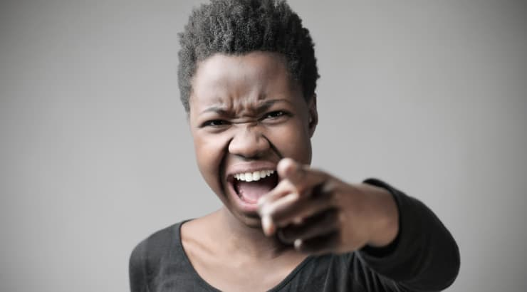 Black Woman Shouting and Pointing At Her Mate Because He Has Been Unfaithful