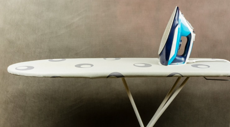 Use an Iron and Ironing Board to Stretch Denims at the Waist