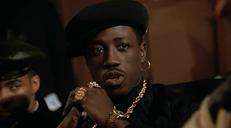 New Jack City is a black film about a ruthless drug lord played by Wesley Snipes